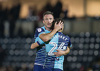 Garry Thompson of Wycombe Wanderers embraces Scott Kashket of Wycombe Wanderers during the Sky Bet League 2 match between Wycombe Wanderers and Hartlepool United at Adams Park, High Wycombe, England on 26 November 2016. Photo by Andy Rowland / PRiME Media Images.