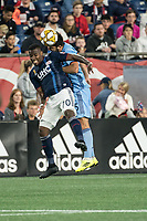 FOXBOROUGH, MA - SEPTEMBER 29: Cristian Penilla #70 of New England Revolution and Eric Miller #5 of New York City FC compete for a high ball during a game between New York City FC and New England Revolution at Gillettes Stadium on September 29, 2019 in Foxborough, Massachusetts.