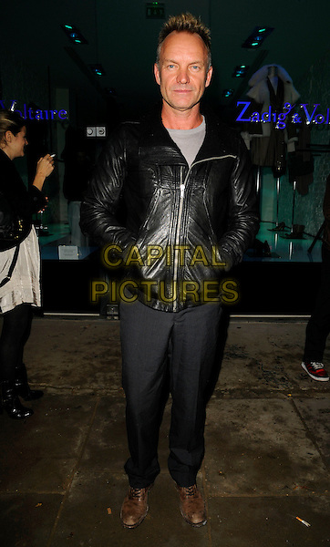 STING aka GORDON SUMNER .Attending the Zadig & Voltaire Store Opening in Westbourne Grove, London, England, October 14th 2008..full length black leather jacket grey gray trousers brown shoes .CAP/CAN.©Can Nguyen/Capital Pictures