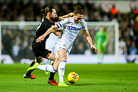 Leeds United's Luke Ayling battles with Hull City's Will Keane<br /> <br /> Photographer Alex Dodd/CameraSport<br /> <br /> The EFL Sky Bet Championship - Leeds United v Hull City - Saturday 29th December 2018 - Elland Road - Leeds<br /> <br /> World Copyright © 2018 CameraSport. All rights reserved. 43 Linden Ave. Countesthorpe. Leicester. England. LE8 5PG - Tel: +44 (0) 116 277 4147 - admin@camerasport.com - www.camerasport.com