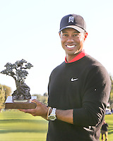 28 JAN 13  Tournament Champion Tiger Woods holds the trophy on18 green at the conclusion of Sunday's Final Round of The Farmers Insurance Open at Torrey Pines Golf Course in La Jolla, California. (photo:  kenneth e.dennis / kendennisphoto.com)