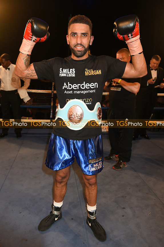 Aaron Morgan (blue shorts) defeats Nodar Robakidze - Boxing at the Camden Centre, Bethnal Green, London - 17/04/15 - MANDATORY CREDIT: Philip Sharkey/TGSPHOTO - Self billing applies where appropriate - contact@tgsphoto.co.uk - NO UNPAID USE