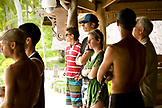 INDONESIA, Mentawai Islands, Kandui Surf Resort, group of people standing together watching the surf