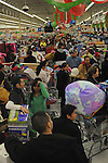 """Shoppers crowd a Wal-mart at 5 A.M. in the northwest Chicago suburb of Niles, Ill. on November 28, 2008, the day after Thanksgiving on the retail shopping spree day known as """"Black Friday.""""  Despite the recession and economic downturn, shoppers still rose early and flocked to big ticket items like flat screen televisions, a popular item at the Wal-mart in Niles."""