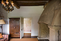 """The open door of this sitting room allows a glimpse of one of the 16th century wall paintings which have been described as """"the most complete, extensive and important domestic decoration of this date in the country?"""