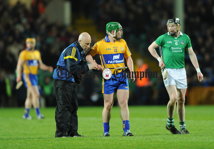 Sean Collins of Clare gets attention for an injury from Physio Diarmuid Horgan during their National League game at The Gaelic Grounds. Photograph by John Kelly.