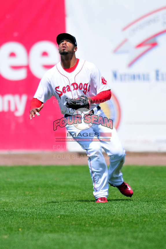 Portland Sea Dogs outfielder Henry Ramos #19 during a game versus the Trenton Thunder at Hadlock Field in Portland, Maine on May 17, 2014. (Ken Babbitt/Four Seam Images)
