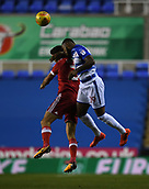 31st October 2017, Madejski Stadium, Reading, England; EFL Championship football, Reading versus Nottingham Forest; Leandro Bacuna of Reading and Eric Lichaj of Nottingham Forest compete in the air