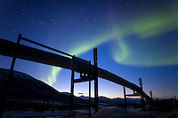 Aurora borealis over the trans alaska pipeline in the Brooks range, arctic, Alaska.