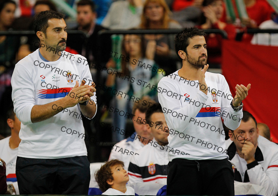 BELGRADE, SERBIA - NOVEMBER 15: Nenad Zimonjic (L) and Janko Tipsarevic (R) of Serbia reacts during the match between Novak Djokovic of Serbia and Radek Stepanek of Czech Republic during the day one of the final Davis Cup match between Serbia and Czech Republic on November 15, 2013 in Belgrade, Serbia. (Photo by Srdjan Stevanovic/Getty Images)