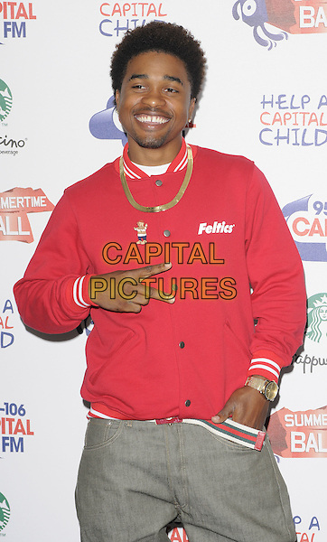 MANN (Dijon Thames Shariff).The Capital FM Summertime Ball, Wembley Stadium, London, England..June 12th, 2011.half length red jacket hands in pockets gold necklace goatee smiling singer rapper artist musician v peace sign.CAP/CAN.©Can Nguyen/Capital Pictures.