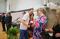 NWA Democrat-Gazette/CHARLIE KAIJO (From center left) Scotty Price of Bentonville hugs Drug Court Coordinator/Counselor Michelle Barrett as he receives his certificate during the Adult Drug Court and Veterans Treatment Court graduation, Friday, June 8, 2018 at the Church of Christ in Bentonville. <br /><br />Some participants in Benton County&acirc;&euro;&trade;s drug and veterans court graduated from the program, their largest class. A ceremony was held Friday and Lt. Governor Tim Griffith was the guest speaker.