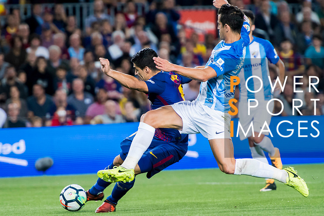 Luis Alberto Suarez Diaz (l) of FC Barcelona is tackled by Luis Hernandez Rodriguez of Malaga CF during the La Liga 2017-18 match between FC Barcelona and Malaga CF at Camp Nou on 21 October 2017 in Barcelona, Spain. Photo by Vicens Gimenez / Power Sport Images