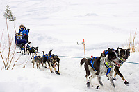 Rohn Buser on the frozen Yukon River approaching Galena on Saturday morning during the 2008 Iditarod