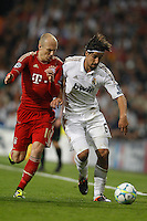 25.04.2012 SPAIN -  UEFA Champions League Semi-Final 2nd leg  match played between Real Madrid CF vs  FC Bayern Munchen 2 (1) - 1 (3) at Santiago Bernabeu stadium. The picture show Arjen Robben  (Midfielders Bayern Munchen) and Sami Khedira (German midfielder of Real Madrid)