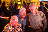 "HONOLULU, Turtle Bay Resort, North Shore, Oahu. - (Thursday, January 3, 2013) Greg Noll (USA) with Randy Rarick (HAW) and Peter Cole (USA) was the guest  speaker of Talk Story at Surfer The Bar tonight, Noll, nicknamed ""Da Bull"" by Phil Edwards in reference to his physique and way of ""charging"" down the face of a wave is an American pioneer of big wave surfing and is also acknowledged as a prominent longboard shaper. Noll was a member of a US lifeguard team that introduced Malibu boards to Australia around the time of the Melbourne Olympic Games. Noll became known for his exploits in large Hawaiian surf on the North Shore of Oahu. He first gained a reputation in November 1957 after surfing Waimea Bay in 25-30 ft surf when it had previously been thought impossible even to the local Hawaiians. He is perhaps best known for being the first surfer to ride a wave breaking on the outside reef at the so-called Banzai Pipeline in November 1964...It was later at Makaha, in December 1969, that he rode what many at the time believed to be the largest wave ever surfed. After that wave and the ensuing wipeout during the course of that spectacular ride down the face of a massive dark wall of water, his surfing tapered off and he closed his Hermosa Beach shop in the early 1970s. He and other surfers such as Pat Curren, Mike Stang, Buzzy Trent, George Downing, Mickey Munoz, Wally Froyseth, Fred Van Dyke and Peter Cole are viewed as the most daring surfers of their generation...Noll is readily identified in film footage while surfing by his now iconic black and white horizontally striped ""jailhouse"" boardshorts and was interviewed by host Jodi Wilmott (AUS). . Photo: joliphotos.com"