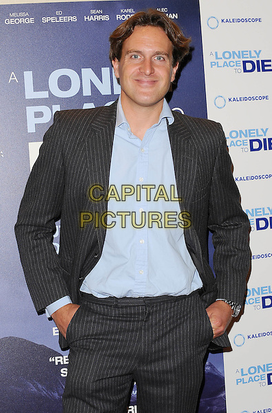 "Julian Gilbey .""A Lonely To Die"" UK Premiere, Empire Leicester Square, London, England..7th September 2011.half length grey gray suit blue shirt hands in pockets .CAP/BEL.©Tom Belcher/Capital Pictures."