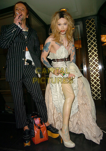 PETE BURNS & PARTNER.At the Miss Great Britain Awards,.Grosvenor House Hotel, London, .25th February 2006..full length wig tattoo tattooes smoking flashing leg plastic stockings funny lifting up dress skirt.Ref: CAN.www.capitalpictures.com.sales@capitalpictures.com.©Capital Pictures