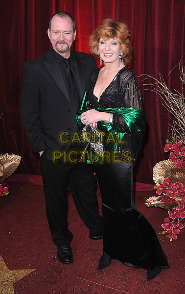 GUEST & RULA LENSKA.Arrivals at the British Soap Awards 2010, London Television Centre, London, England..May 8th, 2010.full length black green shiny wrap shawl jacket long maxi dress clutch bag .CAP/BEL.©Tom Belcher/Capital Pictures.