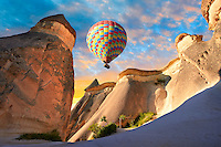 "Pictures & images of hot air balloons over the fairy chimney rock formations and rock pillars of ""Pasaba Valley"" near Goreme, Cappadocia, Nevsehir, Turkey"