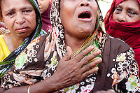 A Bangladeshi woman mourns her missing relative on the one-year anniversary of the garment factory building collapse in Savar, near Dhaka, Bangladesh.