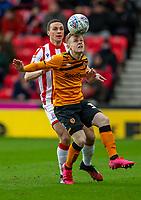 7th March 2020; Bet365 Stadium, Stoke, Staffordshire, England; English Championship Football, Stoke City versus Hull City; Ryan Tafazolli of Hull City has his eye on the ball