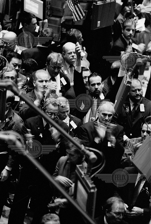 Workers at the New York Stock Exchange return for the first time after the SEptember 11 attacks.