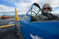 Dale Judge prepares to fly in a 1944 Vultee BT-13 operated by the Alaska Wing of the Commemorative Air Force at Merrill Field. Judge, a cancer survivor, was given the warbird ride as a 70th birthday present from his three sons, two daughters, and sixteen grandchildren-- most of whom were present for the flight. Photo by James R. Evans