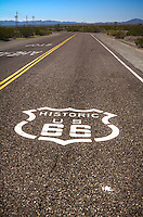 Historic Route 66 roadsign painted on the road in Needles California.