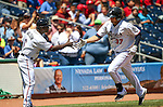 Reno Aces Coach Tack Wilson congratulates Kyle Jensen after hitting a home run against the Iowa Cubsat Greater Nevada Field in Reno, Nev., on Tuesday, May 17, 2016. <br />Photo by Cathleen Allison