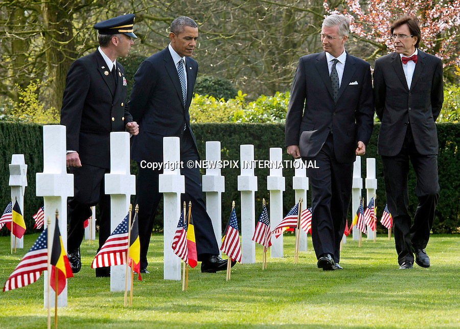 PRESIDENT BARACK OBAMA<br /> visits the Flanders Field American Cemetery and Memorial in Waregem, Belgium, with King Philippe of Belgium and Belgian Prime Minister Elio Di Rupo_26/03/2014<br /> Mandatory Credit Photos:&copy;Pool/NEWSPIX INTERNATIONAL<br /> <br /> **ALL FEES PAYABLE TO: &quot;NEWSPIX INTERNATIONAL&quot;**<br /> <br /> PHOTO CREDIT MANDATORY!!: NEWSPIX INTERNATIONAL(Failure to credit will incur a surcharge of 100% of reproduction fees)<br /> <br /> IMMEDIATE CONFIRMATION OF USAGE REQUIRED:<br /> Newspix International, 31 Chinnery Hill, Bishop's Stortford, ENGLAND CM23 3PS<br /> Tel:+441279 324672  ; Fax: +441279656877<br /> Mobile:  0777568 1153<br /> e-mail: info@newspixinternational.co.uk