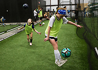 NWA Democrat-Gazette/CHARLIE KAIJO Hailey Crabb, 11, of Bentonville and Reagan Crusinbery, 10, of Centerton (from right) practice juggling skills during a three-day New Year's Soccer Camp, January 4, 2019 at Strike Zone Training Academy in Rogers. <br />