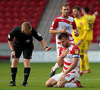 Referee John Busby checks on Doncaster Rovers' Andrew Butler after he goes down injured<br /> <br /> Photographer David Shipman/CameraSport<br /> <br /> The EFL Sky Bet League One - Doncaster Rovers v Fleetwood Town - Saturday 6th October 2018 - Keepmoat Stadium - Doncaster<br /> <br /> World Copyright © 2018 CameraSport. All rights reserved. 43 Linden Ave. Countesthorpe. Leicester. England. LE8 5PG - Tel: +44 (0) 116 277 4147 - admin@camerasport.com - www.camerasport.com