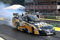 Aug. 2, 2014; Kent, WA, USA; NHRA funny car driver Tony Pedregon during qualifying for the Northwest Nationals at Pacific Raceways. Mandatory Credit: Mark J. Rebilas-