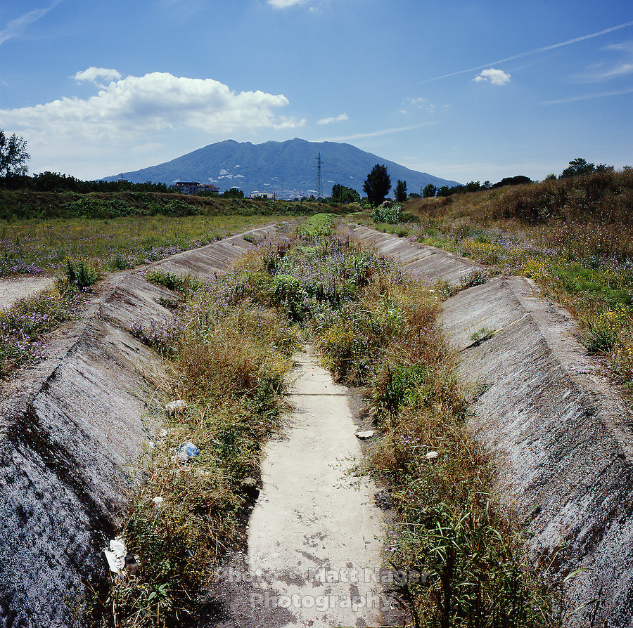 The historical irrigation canal, Vasca San Sossio, no longer transports water, as it is been plugged with concrete due to prevent the spread of toxic waste due to illegal dumping in the canal. The canals, which were created by the Bourbons in the 1700s, brought clean water from Mount Somma, to the fertile agricultural towns living outside Naples. Many families in the area have seen a rise in health issues due to contamination of ground water.  ..PHOTOS/ MATT NAGER