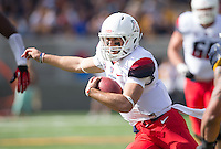 Saturday, November 2nd, 2013: Arizona's B.J. Denker runs away from California defense during a game at Memorial Stadium, Berkeley, Final Score: Arizona defeated California 33-28