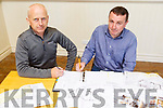Liam Sugrue (Contractor) and Tommy Griffin (Keel Community Centre) putting pen to paper on the contract at the start of the development of the new extension to the Keel Community Centre on Monday evening.