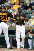 Shortstop Alen Hanson (63) of the Pittsburgh Pirates greets Tony Sanchez (26) after a home run during a spring training game against the New York Yankees on February 26, 2014 at McKechnie Field in Bradenton, Florida.  Pittsburgh defeated New York 6-5.  (Mike Janes/Four Seam Images)