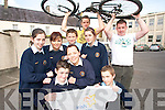 WHEELS OF FIRE: Pupils at Pobal Scoil Sliabh Luachra in Rathmore who have raised funds to sponsor Kilcummin cyclists Kieran Lynch and David Fleming who cycled around Ireland to raise funds for the Irish Cancer Society..Front L/r. Darragh Twomey (Cullen), Steven Nagle (Rathmore)..Second Row L/r. Sinead O'Sullivan (Rathmore), Bridget Foley (Rathmore), Daniel Murphy (Rathmore), Emma Cremin (Gneeveguilla), Katie O'Dea (Knocknagree)..Back L/r. David Fleming and Kieran Lynch.   Copyright Kerry's Eye 2008