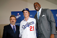 Los Angeles Dodgers General Manager Ned Colletti, Dodgers newest pitcher Zack Greinke, and Dodgers co-owner Magic Johnson during a press conference at Dodger Stadium in Los Angeles, California on December 11, 2012. (Larry Goren/Four Seam Images)