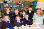 New beginning<br /> --------------------<br /> Maire Collins teacher&amp;principal at Knocknagoshel NS with her junior infants last Tuesday.