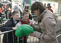 17/03/2011.Parade Grandmaster Katie Taylor signs autogrpahs for Mikey McCoy (12) & Noel Cummins (12) both from Crumlin.during the St. Patrick's Day festival in Dublin's City Centre..Photo: Gareth Chaney Collins