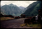 The view from Telluride looking east toward Pandora.  Goose #3 is parked at the fuel shack.<br /> RGS  Telluride, CO  Taken by Maxwell, John W. - 7/13/1946
