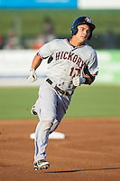 Evan Van Hoosier (17) of the Hickory Crawdads hustles towards third base against the Kannapolis Intimidators at CMC-Northeast Stadium on May 19, 2014 in Kannapolis, North Carolina.  The Crawdads defeated the Intimidators 10-6.  (Brian Westerholt/Four Seam Images)