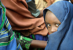 Nine-year old Habiba Husseim Hassan, a Somali girl whose family fled drought and war at home to trek for a month across east Africa, waits with her family to be registered in the Dadaab refugee camp in northeastern Kenya. Fleeing violence and drought, hundreds of thousands of Somali refugees have made Dadaab the largest refugee settlement in the world.