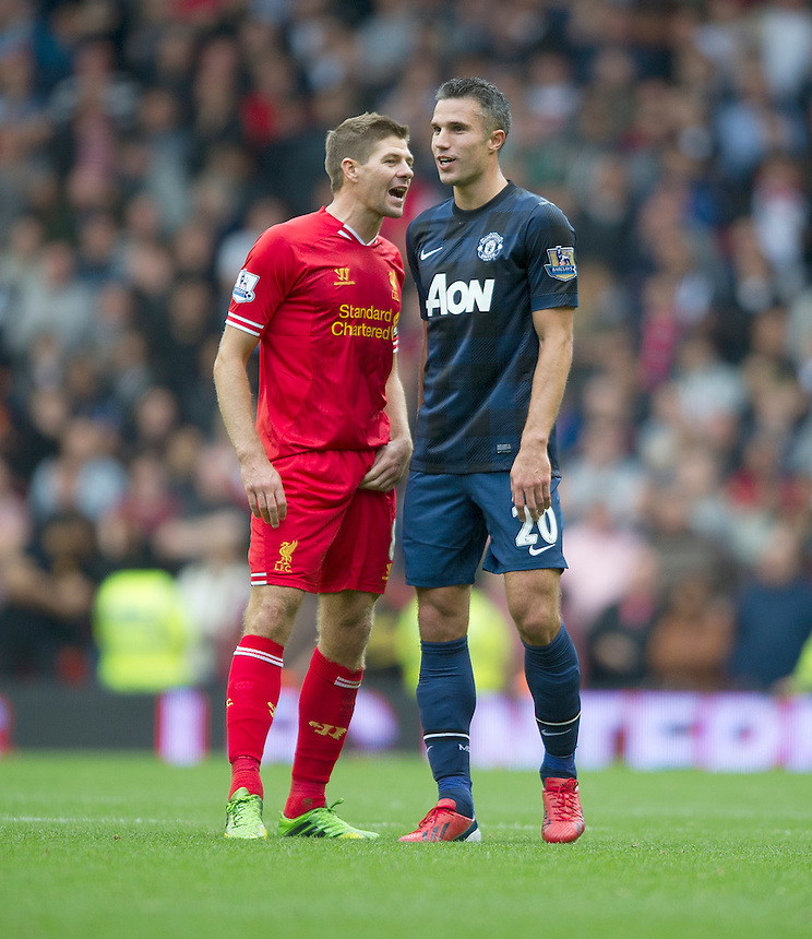 Manchester United's Robin van Persie squares up to Liverpool's Steven Gerrard as both players are spoken to by Referee Andre Marriner<br /> <br /> Photo by Stephen White/CameraSport<br /> <br /> Football - Barclays Premiership - Liverpool v Manchester United - Sunday 1st September 2013 - Anfield - Liverpool<br /> <br /> &copy; CameraSport - 43 Linden Ave. Countesthorpe. Leicester. England. LE8 5PG - Tel: +44 (0) 116 277 4147 - admin@camerasport.com - www.camerasport.com