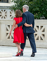 Associate Justice of the Supreme Court of the United States Neil M. Gorsuch, right, and his wife, Marie Louise, left, walk away after posing for photos on the front steps of the US Supreme Court Building after the investiture ceremony for Justice Gorsuch in Washington, DC on Thursday, June 15, 2017. Photo Credit: Ron Sachs/CNP/AdMedia