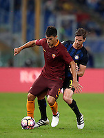 Calcio, Serie A: Roma vs Inter. Roma, stadio Olimpico, 2 ottobre 2016.<br /> Roma&rsquo;s Diego Perotti, left, is challenged by FC Inter&rsquo;s Cristian Ansaldi during the Italian Serie A football match between Roma and FC Inter at Rome's Olympic stadium, 2 October 2016.<br /> UPDATE IMAGES PRESS/Isabella Bonotto