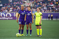 Orlando, Florida - Sunday, May 8, 2016: Orlando Pride midfielder Lianne Sanderson (10) and defender Stephanie Catley (7) set up a free kick as Seattle Reign FC midfielder Kim Little (8) helps to set up her team's wall during a National Women's Soccer League match between Orlando Pride and Seattle Reign FC at Camping World Stadium.
