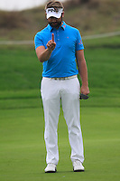 Matthew Baldwin (ENG) lines up his putt on the 5th green during Saturay's Round 3 of the 2014 BMW Masters held at Lake Malaren, Shanghai, China. 1st November 2014.<br /> Picture: Eoin Clarke www.golffile.ie